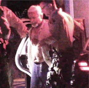 The suspect, whose name was not immediately released, is taken into custody Tuesday, Oct. 13. (LUIS MEZA)