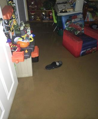 Reader submitted photo shows a flooded home on 70th West and Avenue L. [contributed]