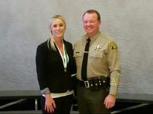 Elizabeth Ann Herring and Sheriff Jim McDonnell at the department's Valor Awards ceremony at at USC's Galen Center Tuesday, Nov. 3. [contributed]