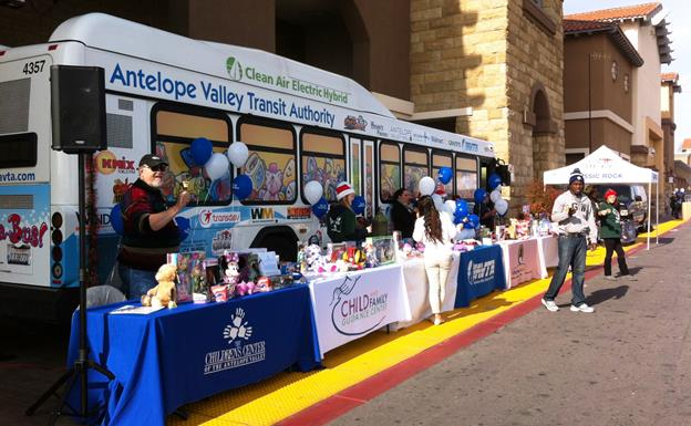 The Stuff-a-Bus roll-out kicks off the transit agency's annual holiday toy drive, with the goal of collecting enough new unwrapped toys, clothing and gifts to completely fill up the 40-foot bus. [contributed]