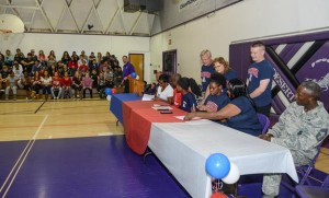 Devyn Cross and Elizabeth Shelton signed National Letters of Intent in the Desert High School Gym while members of the student body cheered them on. (Rebecca Amber)
