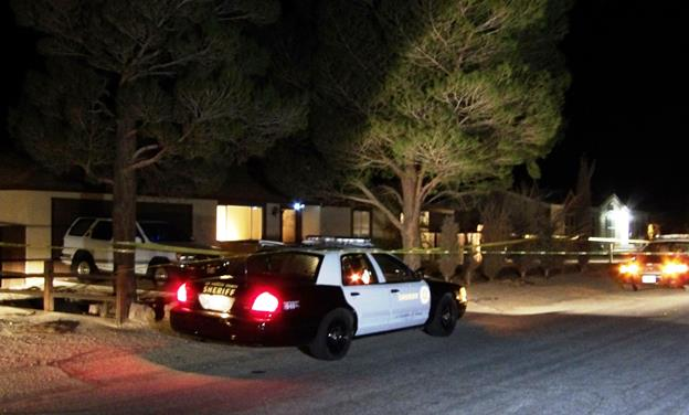 Homicide detectives investigate Friday night at a home on the 15800 block of Greenrock Avenue, where a woman was found dead. (Photo by LUIS MEZA]