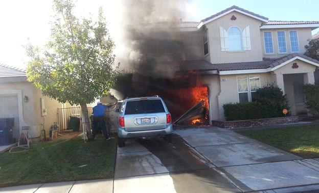 As they waited for the fire department to arrive, a retired fireman jumped the fence from the adjacent golf course, grabbed a water hose, and tried to keep the vehicle in the driveway from getting damaged, Gockel said. [Contributed photo by DON GOCKEL]