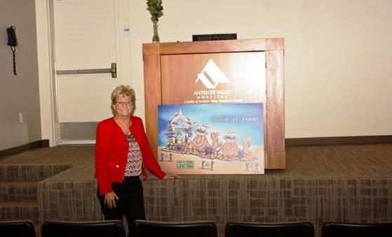 Senator Sharon Runner poses with an artist's rendering of the Donate Life float following the Donate Life Rose ceremony on Nov. 9. [contributed]