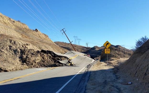 Pavement is tearing as soil slides beneath Vasquez Canyon Road, according to the Los Angeles County Department of Public Works. [Image courtesy LA Co Public Works via twitter.]