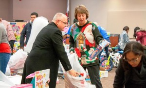 It took less than an hour to bag the toys and load them into the charities' trucks, with the help of Assemblyman Tom Lackey  [left] and AVTA Vice-Chair Dianne Knippel [right]. (contributed)