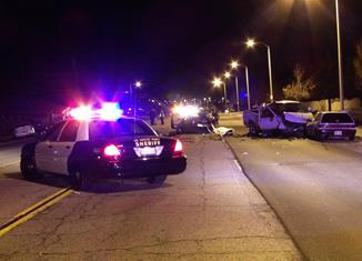 The Ford pick-up truck came to rest against a westbound Honda Civic hatchback, sheriff's officials said. [LUIS MEZA]
