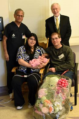 AVH Neonatologist Dr. Murugesa M. Thangavel and AVH Chief Executive Officer John Rossfeld congratulate parents Erica and Steven Lockshin on the arrival of their first child, Isabel Hannah Lockshin. [contributed]
