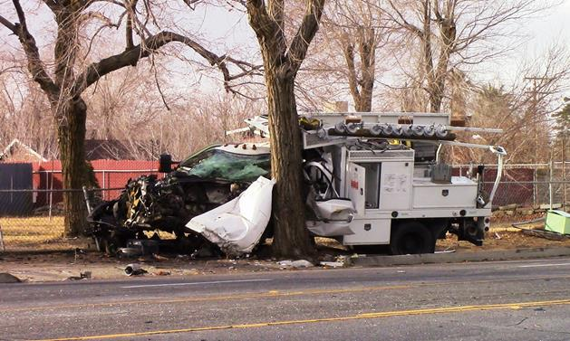 The truck hit a power pole and then crashed into a tree on Avenue J near Andale Avenue in Lancaster, sheriff's officials said. [Photo by LUIS MEZA]
