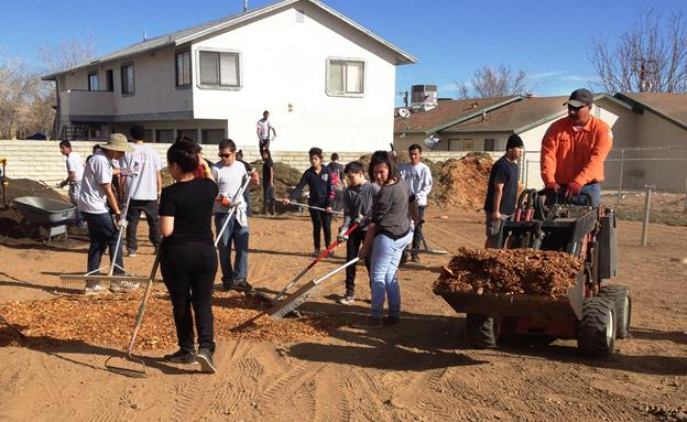 Photo of a 2015 Season of Service project at the city's community garden. [contributed]
