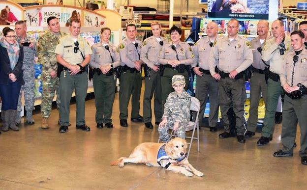 "George Rios and ""Katie"" spend time with deputies from the Palmdale and Lancaster Sheriff's Stations. [contributed]"
