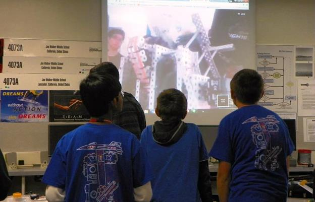 For the past four months, the Vex Jets Robotics team at Joe Walker Middle School has video-conferenced students in Japan to offer advice on building and programming robots and to explain the challenges a team may face and its first competition. [contributed]