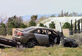 The female driver was unable to exit the fiery vehicle, the CHP reported. [LUIS MEZA]