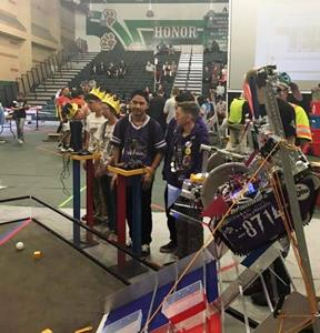 Members of Team 8714 controlling the robot during competition. [contributed]