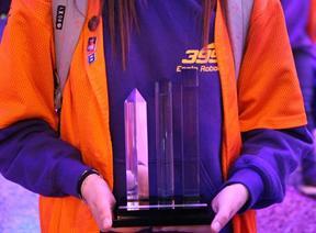 Team 399 member Lanyell Bowman holding the Entrepreneurship Award. [contributed]