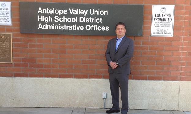 Antelope Valley Freethinkers President David Dionne stands in front of the offices of the Antelope Valley Union High School District. [contributed]
