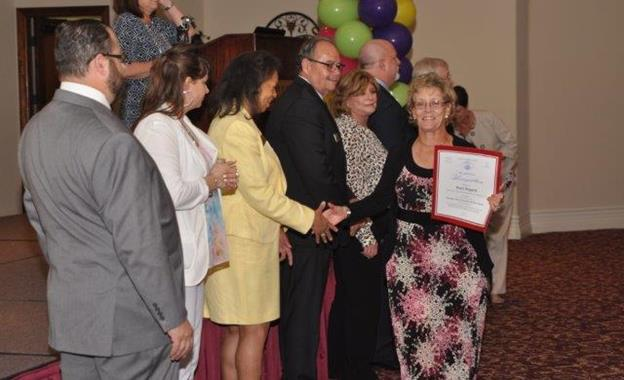 Pearl Bogard, who has volunteered more than 4,000 hours at the hospital in just five years, accepts her certificate of recognition [contributed]