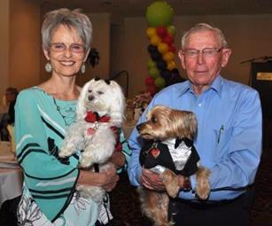 Volunteers Karen and Chuck Duty, who together have volunteered more than 1,000 hours, pose with pet-therapy volunteers, Daisy Mae and Cody Jake. [contributed]