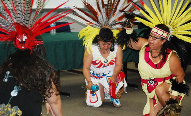 Aztec dancers perform at the event to announce details of the inaugural Community Cultural Heritage & Service Day. [contributed]