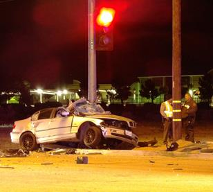 The BMW struck a traffic pole and its driver was pronounced dead at the scene. [LUIS MEZA]
