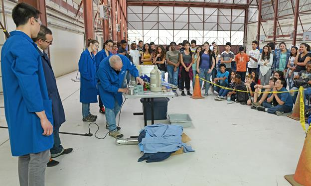 "From lessons on chemical propellants to seeing actual rocket boosters that were launched, the 8th-graders from Discovery School in Lancaster, California, got a whirlwind tour of the ""Rocket Lab"" April 19. (U.S. Air Force photo by Kenji Thuloweit)"