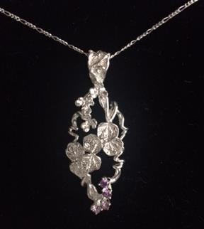 One of the raffle prizes is an amethyst crystal pendant created by local artist Ray James. (contributed)