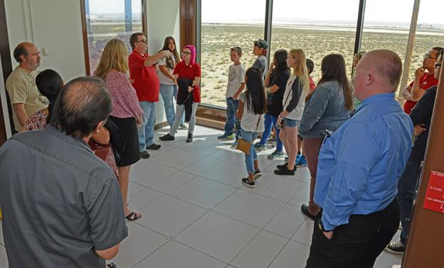 Students from local schools get to look out the observation area on the third floor of the Integrated Facility for Avionics Systems Test. The International Test and Evaluation Association's local Antelope Valley chapter held its annual grant luncheon there where seven school clubs received grants to further advance their programs. (U.S. Air Force photo by Kenji Thuloweit)