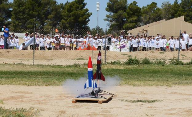 Students cheered as the rockets they built were launched into the sky May 12. The competition included 4th-6th grade classes that work on a Big Daddy Rocket Kit for around two weeks leading up to the big day. (U.S. Air Force photo by Kenji Thuloweit)