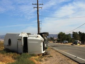 The water truck overturned and its driver, 58-year-old Keith L. Quigley of Apple Valley, sustained minor injuries. [LUIS MEZA]