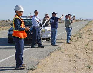 Edwards AFB partnered with Lancaster and contractor Worldwide Waste Management to transport four five-gallon drums of nitrocellulose-dope lacquer to base for disposal. The Sheriff's Department helped escort the transport of the chemical. (Kenji Thuloweit)