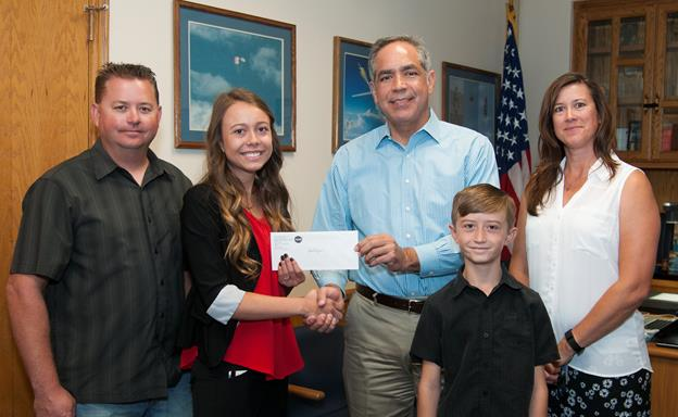 Katelynn Dinius, second from left, accepts the 2016 NASA Armstrong Exchange Thomas W. Finch Scholarship from Center Director David McBride. From left are Clint Dinius, Katelynn, McBride, Joe Dinius and Dede Dinius. [NASA photo / Lauren Hughes]