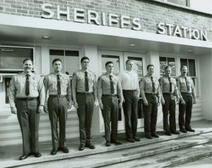 Ahrens [fourth from right] was employed by the sheriff's department as a dispatcher from 1991 to 2002, and was stationed at the Lennox and Lancaster stations. [LASD]