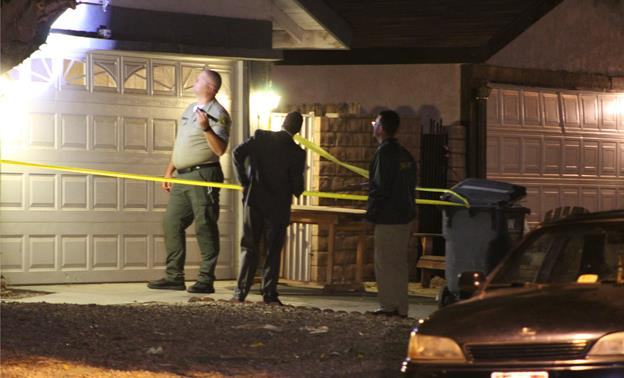 The victim was found unconscious, suffering from multiple gunshot wounds, in the backyard of a residence on the 44000 block of Gingham Avenue in Lancaster. [Photo by LUIS MEZA]