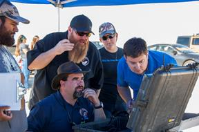 Jonathan Adams, from left, John Bodylski, Justin Hall, Caitlin Kennedy and Dave Berger watch a computer screen providing the Prandtl-M's location and altitude. [NASA Photo / Kyria Luxon]