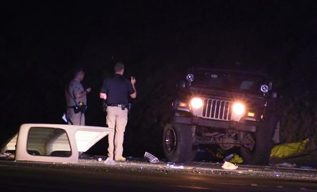 Both occupants of the 2004 Jeep Rubicon were ejected. [Photo by LUIS MEZA]