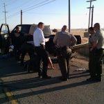 Sheriff's detectives examine the suspects pickup truck Friday morning. [Image courtesy LASD]