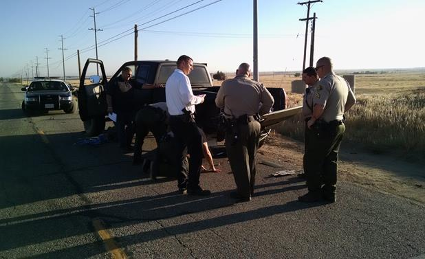 Sheriff's detectives examine the suspects pickup truck Friday morning. [Image courtesy LASD]