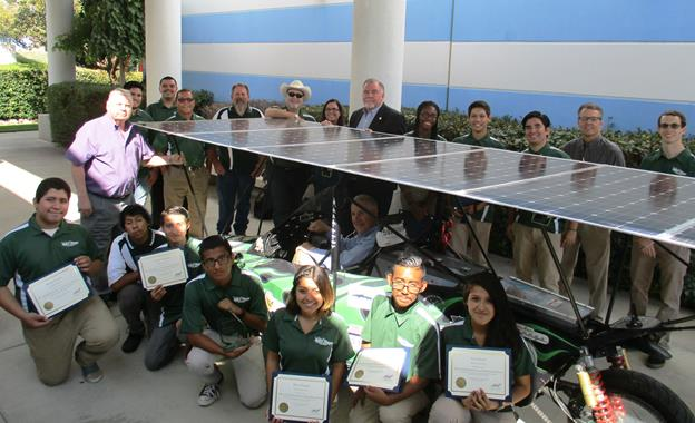 Palmdale High School's Solar Falcon Race Team and AVAMQD Board members. [Contributed photo.]