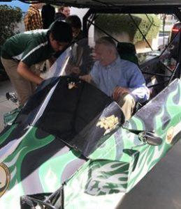 Lancaster Lancaster Councilmember Ken Mann tries out the team's solar car. [contributed]