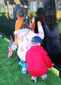 Visitors of all ages viewed the wall last year.