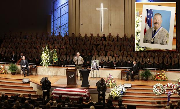 Thousands of law enforcement officials and members of the community gathered for the funeral of slain Los Angeles County Sheriff's Sgt. Steve Owen at Lancaster Baptist Church Oct. 13 in Lancaster. (Irfan Khan / Los Angeles Times)