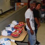 Volunteers are needed to help South Antelope Valley Emergency Services (SAVES) prepare for its annual holiday food and gift distribution, which will help more than 500 local families. [Contributed photo from past volunteer event.]
