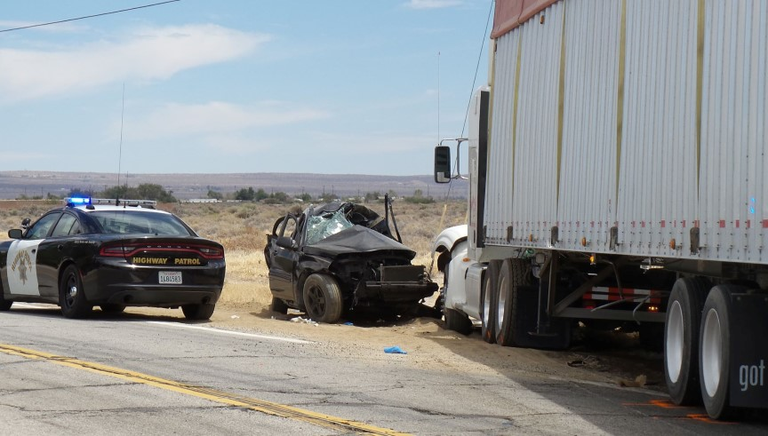 Two killed, three injured in vehicle-big rig collision in